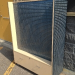 Double sided metal pegboard unit