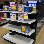 End cap for gondola shelving run