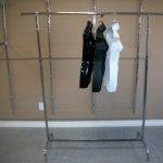 Wall standards with straight garment rack +hanging busts - in front.
