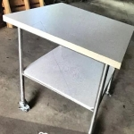 Square dual level table with lockable wheels