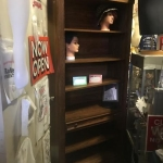 Book shelving unit with lights and drawer