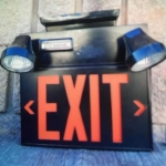 Emergency EXIT sign with battery backed up lights in black finish