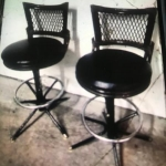 Pair of bar swivel stools with back and feet rest